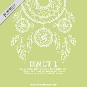 Groene achtergrond met schetsen dreamcatcher