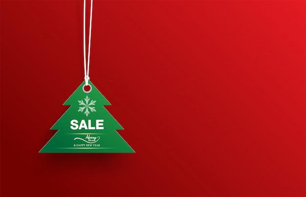 Groene de verkoop witte sneeuwvlok van de etiketkerstboom op rood