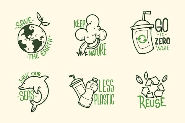 Groene hand getekend ecologie badges