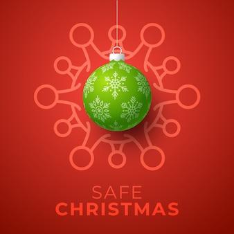 Groene kerstbal en gevaar voor het coronavirus in quarantaine. coronavirus covid-19 en kerst- of nieuwjaarsgeannuleerd concept.