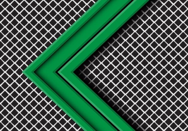 Groene pijl overlapping op grijze metalen vierkante mesh achtergrond.