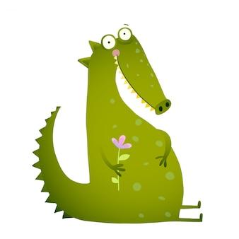Groene schattige kinderen krokodil zitten met bloem