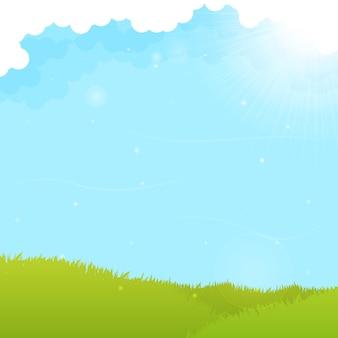 Groene veld en blauwe hemelachtergrond