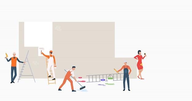 Groep bouwers met hulpmiddelen die muurbanner schilderen