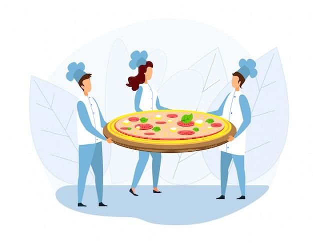 Groep chef-kok holding huge pizza op tray metafhor