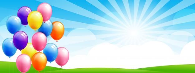Groep een realistische kleurrijke ballon op blauwe lucht en veld