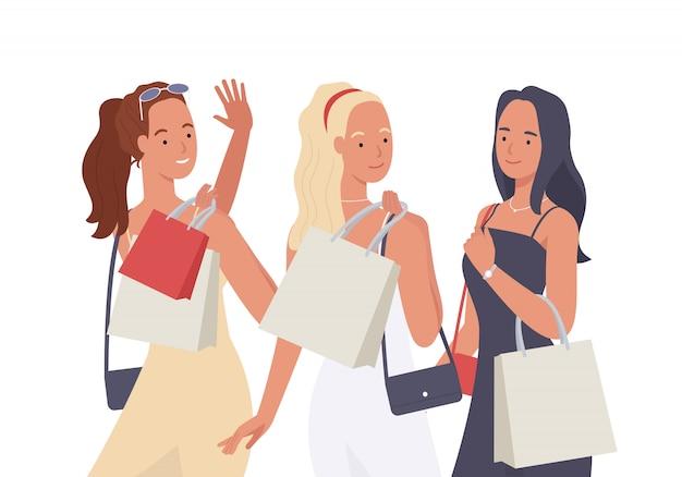 Groep jonge mooie vrouw met boodschappentas genieten van winkelen.