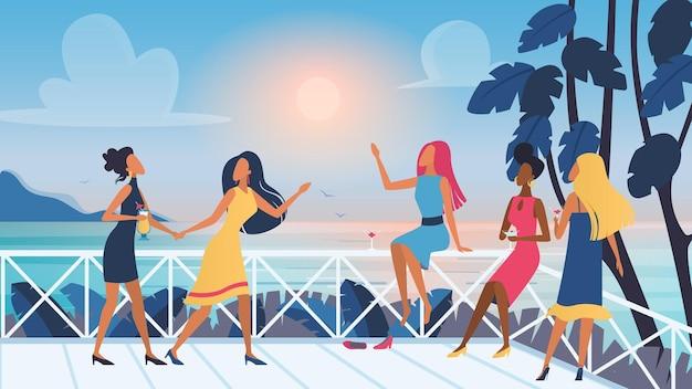Groep jonge vrouwen vrienden ontspannen tijd samen doorbrengen op openlucht terras zonsondergang zeezicht
