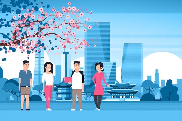 Groep koreaanse mensen over de stad van seoel