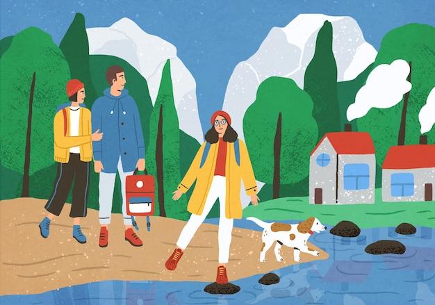 Groep leuke gelukkige vrienden wandelen of backpacken in bos of bos aan rivier of meer