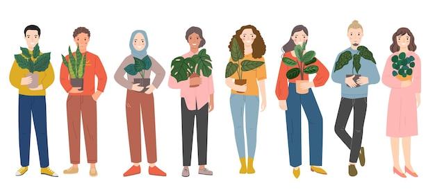 Groep mensen die planten houden.