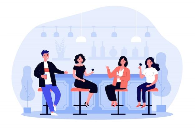 Groep mensen die wijn en bier in pub drinken