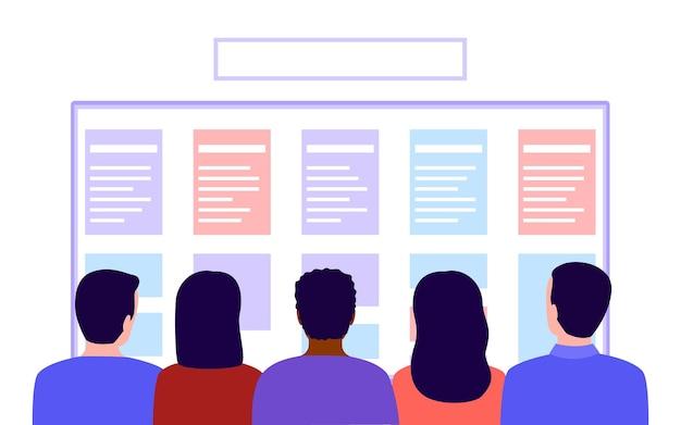 Groep mensen kijkt naar lijst plan werk of trainingsschema achteraanzicht mensen lezen inhoud