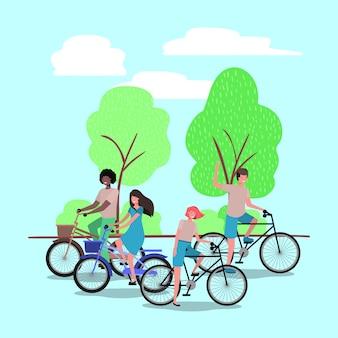 Groep mensen op fiets in het park