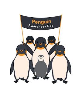 Groep pinguïns met een poster penguin awareness day.
