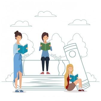 Groep studenten die boeken in het park lezen