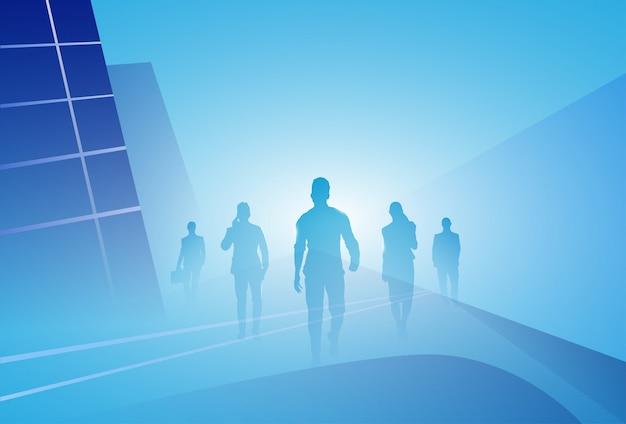 Groep van bedrijfsmensen silhouet zakenmensengang stap voorwaarts over abstracte achtergrond