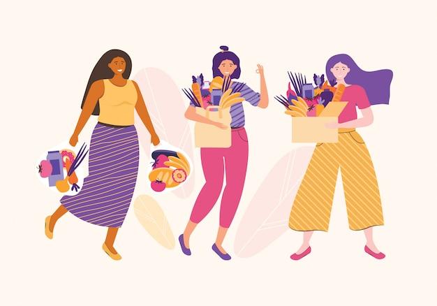 Groep vrouwen glimlacht en houdt een kartonnen doos, papieren verpakkingen en zak vol met groenten en fruit terwijl. ecologisch eten en vegetarisch. vrouw karakter dieet en gezond eten