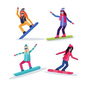 Groep vrouwen snowboarden