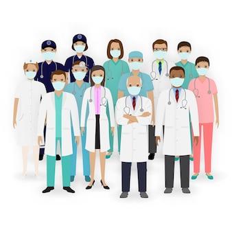 Groepeer artsen, verpleegsters en paramedici in maskers. medisch team. ziekenhuispersoneel.