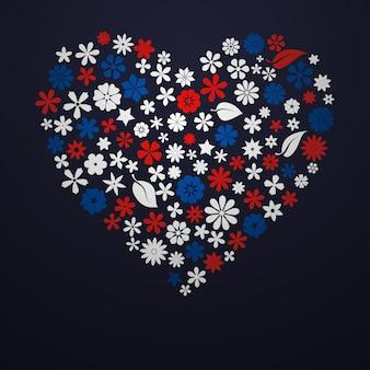 Groot hart bestaande uit bloemen en bladeren, wit, blauw en rood op zwarte achtergrond