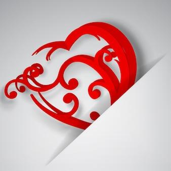 Groot rood hart met krullen ingevoegd in een uitsparing in een vel wit papier
