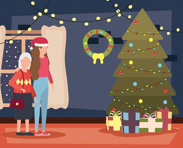 Grootmoeder en dochter in woonkamer met kerstmisdecoratie