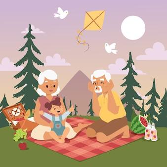 Grootmoeder en grootvader spelen samen met hun gelukkige jonge kleindochter op een openluchtpicknick in de zomer