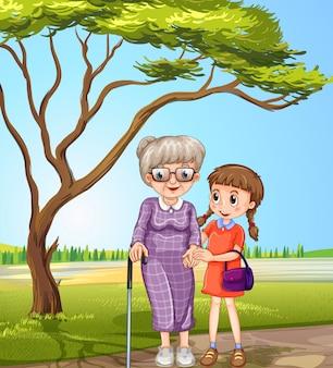 Grootmoeder en kind in het park