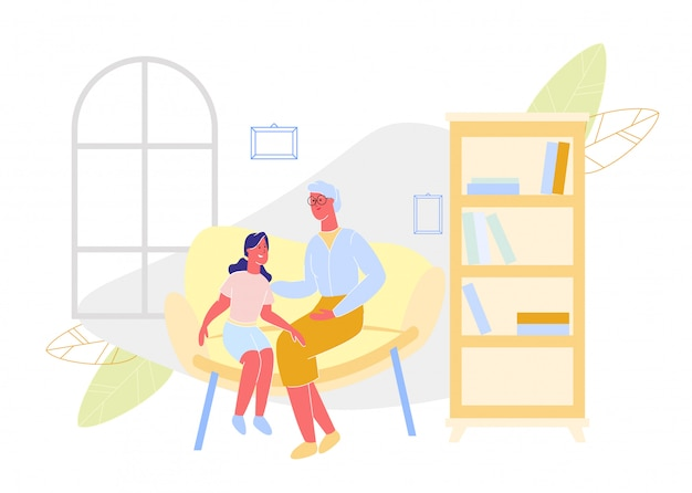 Grootmoeder en kleindochter op sofa in appartement