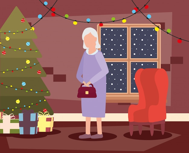 Grootmoeder in woonkamer met kerstmisdecoratie