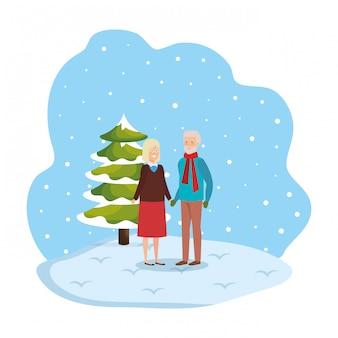 Grootouders koppelen met winterkleren in snowscape