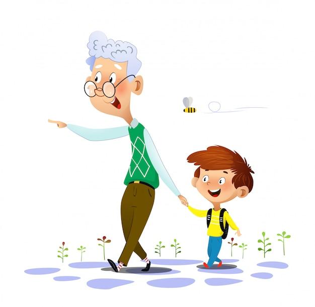 Grootvader loopt met zijn kleinzoon en praat met hem