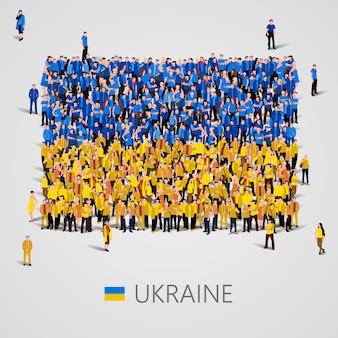 Grote groep mensen in de vorm van de vlag van oekraïne