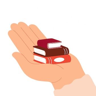 Grote menselijke hand houdt stapel van drie boeken. concept van donatie, onderwijs, leren. werelddag voor het boek