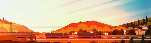 Grote semi vrachtwagenaanhangwagens die weg over bergenlandschap drijven bij zonsondergang horizontale banner