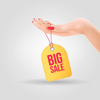 Grote verkoop belettering op tag opknoping bij de hand