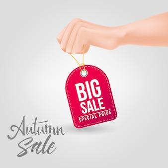 Grote verkoop, speciale prijs belettering op tag vastgehouden met de hand