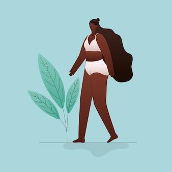 Grote zwarte vrouwencartoon in ondergoed met bladerenontwerp, thema love and care yourself