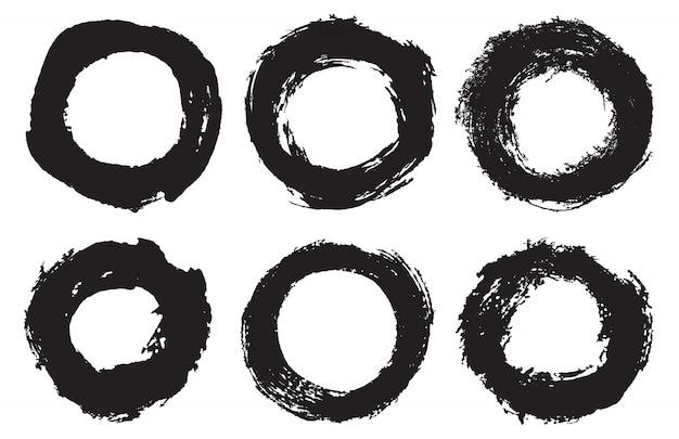 Grunge penseelstreek cirkels set