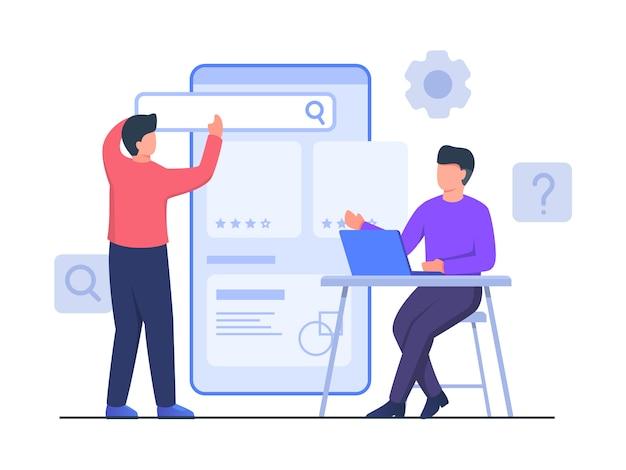 Guy zit stoel bezig met laptop samenwerking met partner setting ui op grote smartphone creëer app-ontwerp met platte cartoonstijl.