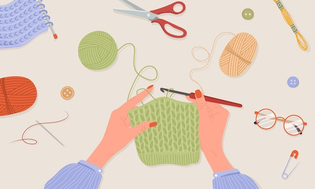 Haak breiproces. vrouwelijke handen met haak en draad.