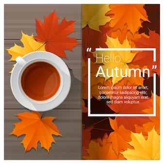 Hallo herfst achtergrond met een kopje thee op een houten bord