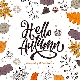 Hallo herfst belettering achtergrond met bladeren