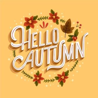 Hallo herfst belettering met getekende bladeren en bloemen