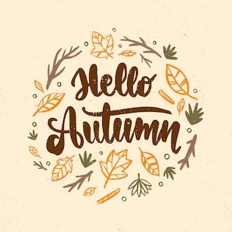 Hallo herfst belettering met getekende bladeren