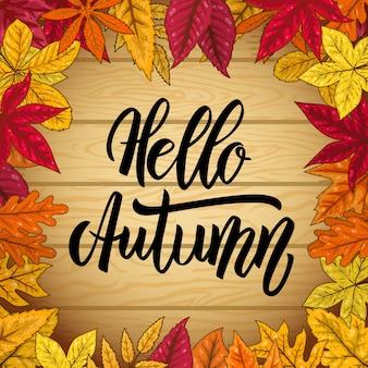 Hallo herfst. houten achtergrond met herfstbladeren.