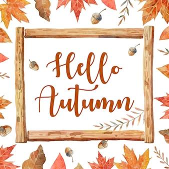 Hallo herfst in houten kozijnen en omgeven door herfstbladeren zoals esdoorn, eiken en walnoot.