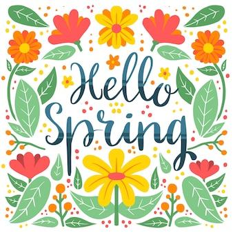 Hallo lente belettering met kleurrijke bloemen en bloemblaadjes