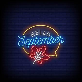 Hallo september neon uithangbord op bakstenen muur